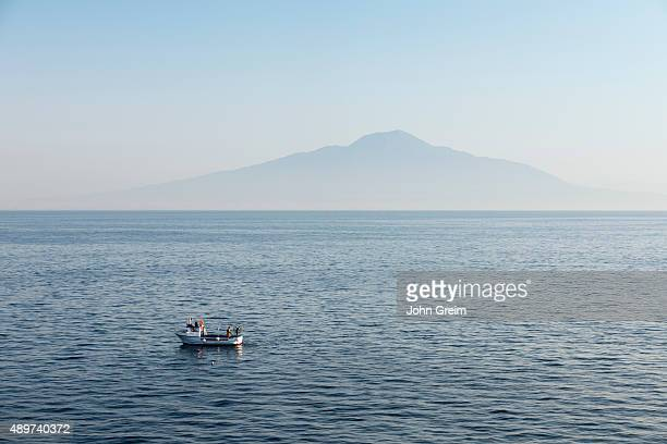Commercial fisherman checks his traps in the shadow of Mount Vesuvius