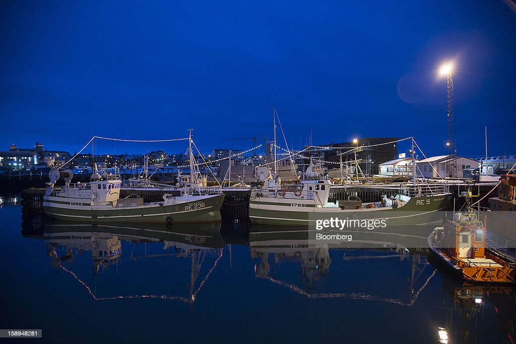 Commercial fishing vessels sit at their moorings on the quayside at the harbor in Reykjavik, Iceland, on Tuesday, Jan. 1, 2013. Iceland's inflation rate eased in December as central bank efforts to stabilize the krona with interest rate increases paid off. Photographer: Arnaldur Halldorsson/Bloomberg via Getty Images