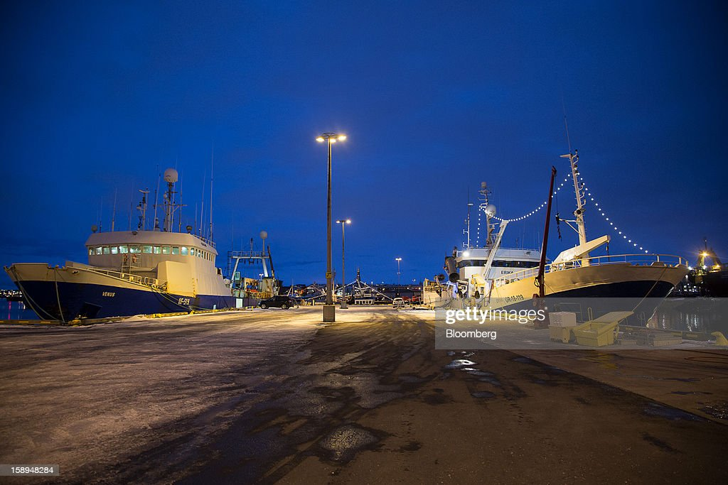 Commercial fishing vessels sit illuminated by lights on the quayside at the harbor in Reykjavik, Iceland, on Tuesday, Jan. 1, 2013. Iceland's inflation rate eased in December as central bank efforts to stabilize the krona with interest rate increases paid off. Photographer: Arnaldur Halldorsson/Bloomberg via Getty Images