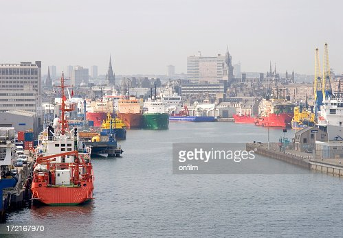 A commercial harbor with multiple multi color ships