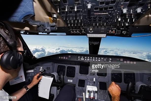 Commercial jet above the clouds...cockpit with young captain