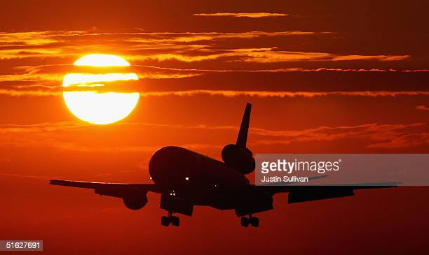 A commercial jet plane comes in for a landing at Miami International Airport October 29 2004 in Miami Florida