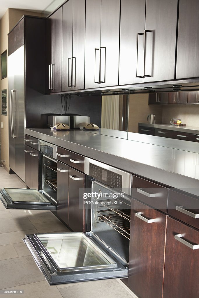 Commercial Kitchen With Open Oven And Cabinets : Stock Photo