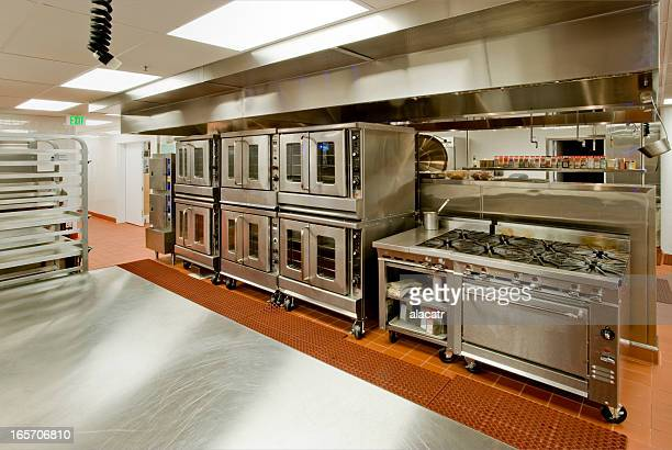 Commercial Kitchen with Prep Table, stove, and Ovens