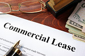 Commercial Lease agreement with money on a table.
