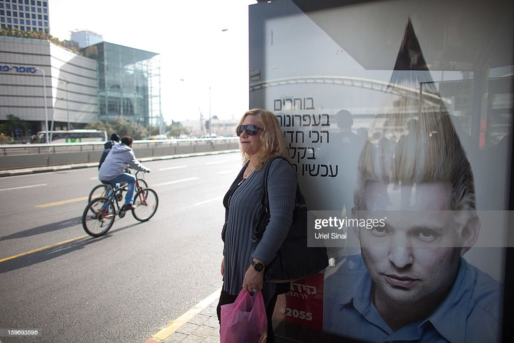 A commercial poster for an Israeli school with the manipulated image Naftali Bennett, Head of HaBayit HaYehudi Party, or the Jewish Home party, hangs on a bus stop ahead of the upcoming Israeli elections on January 18, 2013 in Tel Aviv, Israel. Israeli elections are scheduled for January 22 and so far showing a majority for the Israeli right.