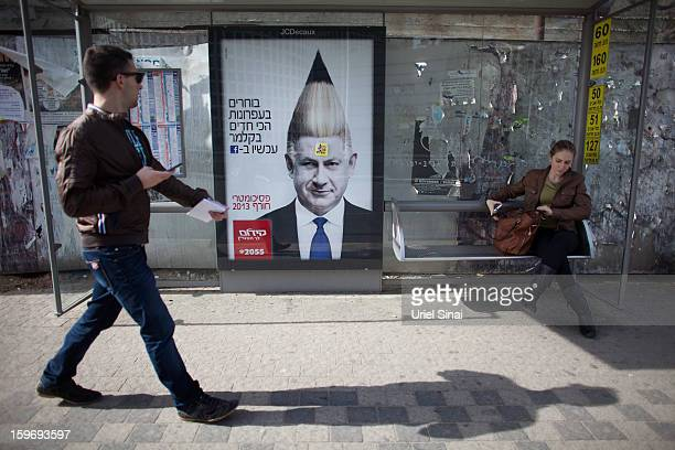 A commercial poster for an Israeli school with the manipulated image Israeli Prime Minister Benjamin Netanyahu hangs on a bus stop ahead of the...
