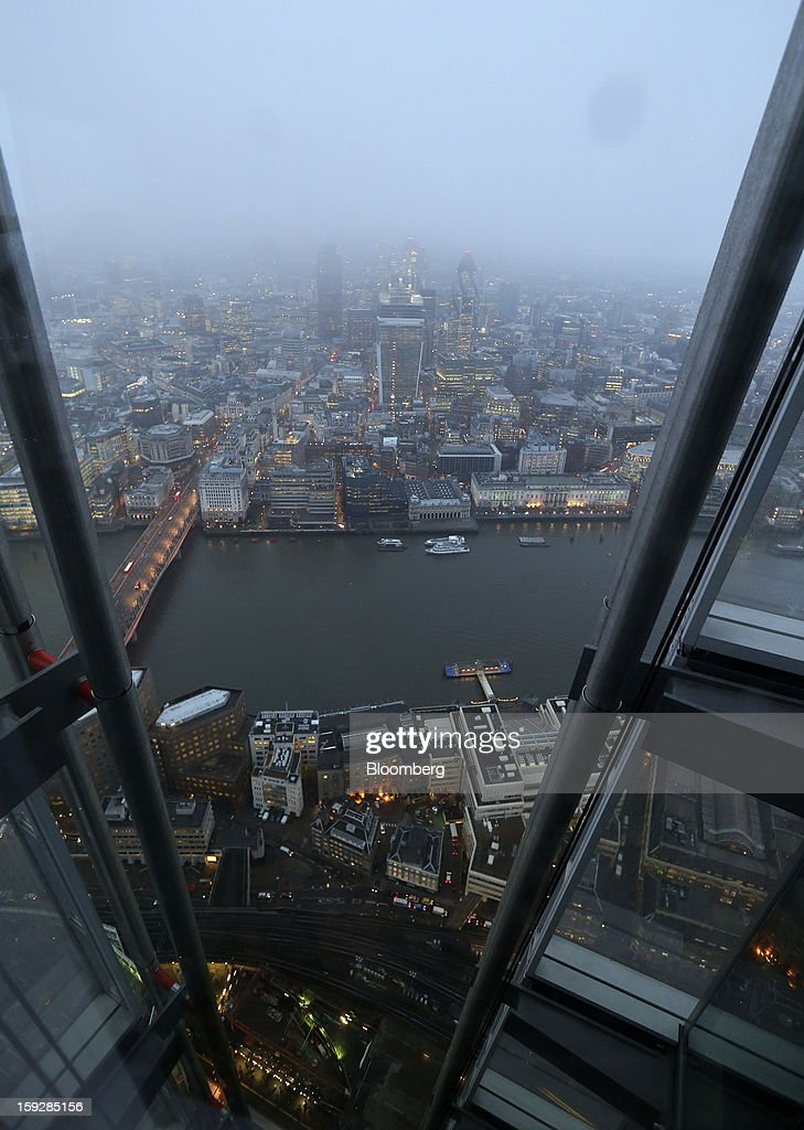 Commercial real estate and office buildings are seen illuminated in the early morning and viewed from 'The View From The Shard', a series of viewing galleries near the top of the Shard tower in London, U.K., on Wednesday, Jan. 9, 2013. The Shard, which stands at 309.6 meters on London's South Bank, is owned by LBQ Ltd., which brings together the State of Qatar (the majority shareholder) and Sellar Property Group Ltd., with non-equity funding by Qatar National Bank. Photographer: Chris Ratcliffe/Bloomberg via Getty Images