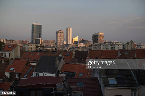 Commercial skyscrapers stand on the city skyline beyond tiled rooftops in the northern quarter business district top in Brussels Belgium on Thursday...