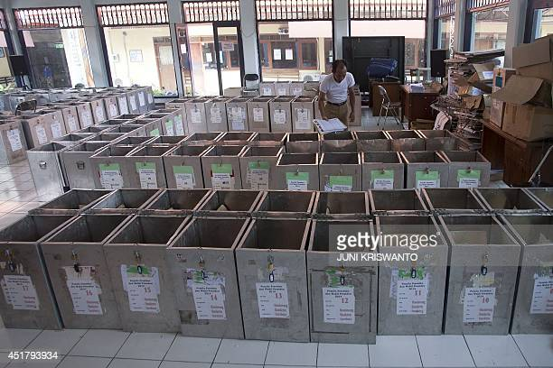 Commission on Election personnel prepare ballot boxes in Surabaya city in eastern Java island for distribution to districts on July 7 2014...