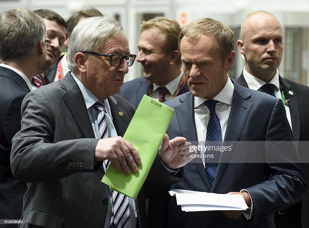 EU Commission President Jean Claude Juncker and EU Council President Donald Tusk arrive for a joint press during a EU Summit meeting at the EU headquarters in Brussels on June 29, 2016. / AFP / JOHN