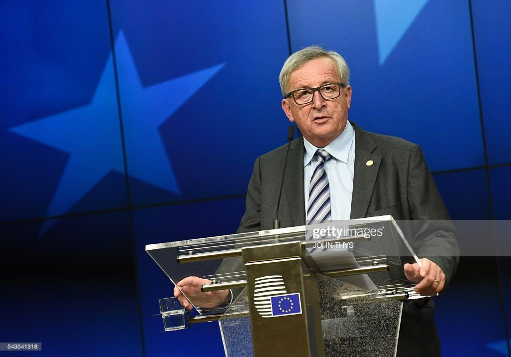 EU Commission President Jean-Claude Juncker gives a press conference during a EU Summit meeting at the EU headquarters in Brussels on June 29, 2016. European leaders met on June 29 without Britain for the first time in 40 years to prepare for life after the Brexit bombshell, as the race began to succeed Prime Minister David Cameron. The 27 EU leaders will also hold a summit -- without Britain -- in Bratislava on September 16 to discuss further the fallout from Britain's decision to leave the bloc, Tusk said. / AFP / JOHN