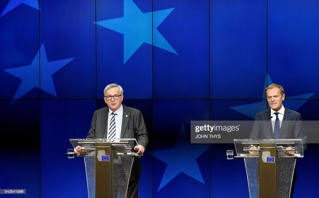 EU Commission President Jean-Claude Juncker (L) gives a press conference with EU Council President Donald Tusk (R) during a EU Summit meeting at the EU headquarters in Brussels on June 29, 2016. European leaders met on June 29 without Britain for the first time in 40 years to prepare for life after the Brexit bombshell, as the race began to succeed Prime Minister David Cameron. The 27 EU leaders will also hold a summit -- without Britain -- in Bratislava on September 16 to discuss further the fallout from Britain's decision to leave the bloc, Tusk said. / AFP / JOHN