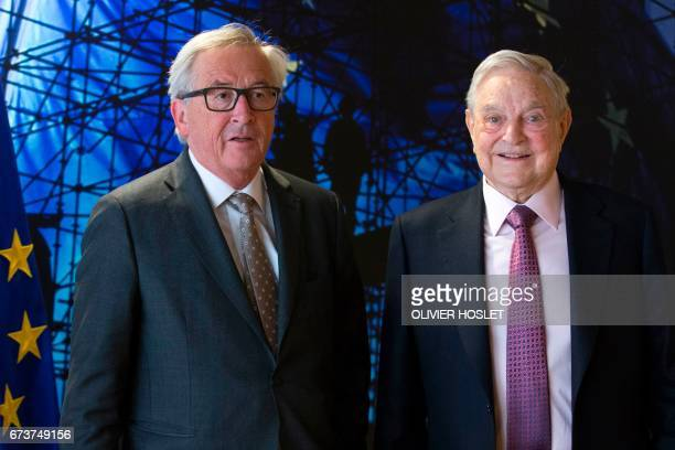EU commission President JeanClaude Juncker welcomes George Soros Founder and Chairman of the Open Society Foundations prior to a meeting in Brussels...