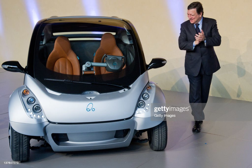 Commission President Jose Manuel Barroso looks at the first prototype of the HIRIKO electric car during the global launch of Hiriko Driving Mobility...