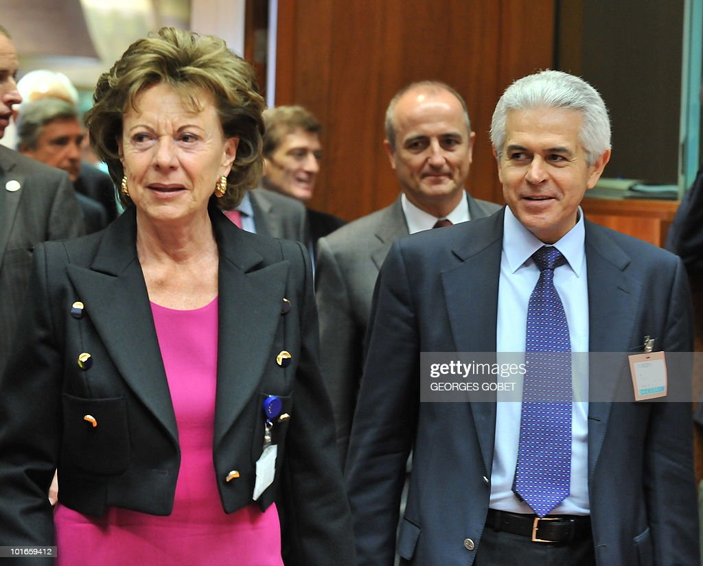 EU Commission Vice President Neelie Kroes (L) and Spanish Telecommunications and Information Society State Secretaryr Francisco Ros Peran arrive on May 31, 2010 for a Telecommunications Council meeting at EU headquarters in Brussels.