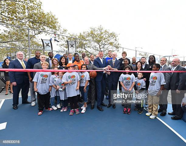 Commissioner Adam Silver and New York City Mayor Bill de Blasio and Executive Director of the NBA Players Association Michelle Roberts cut the ribbon...