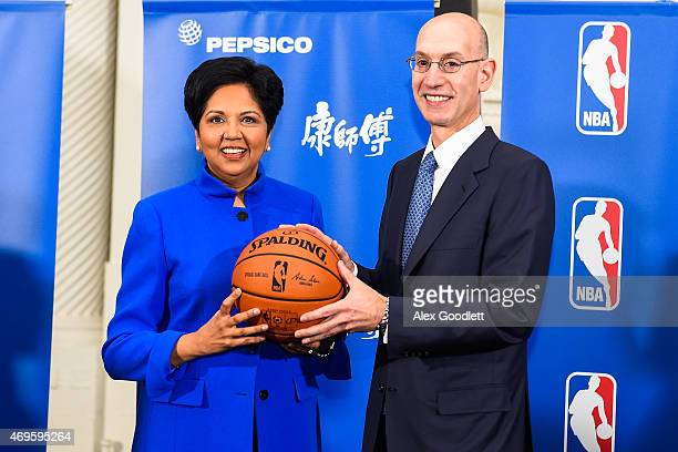 Commissioner Adam Silver and PepsiCo CEO Indra Nooyi pose for a picture after a press conference to announce a marketing partnership between the NBA...