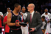 Commissioner Adam Silver awards the MVP Trophy to Russell Westbrook of the Oklahoma City Thunder and the Western Conference after defeating the...