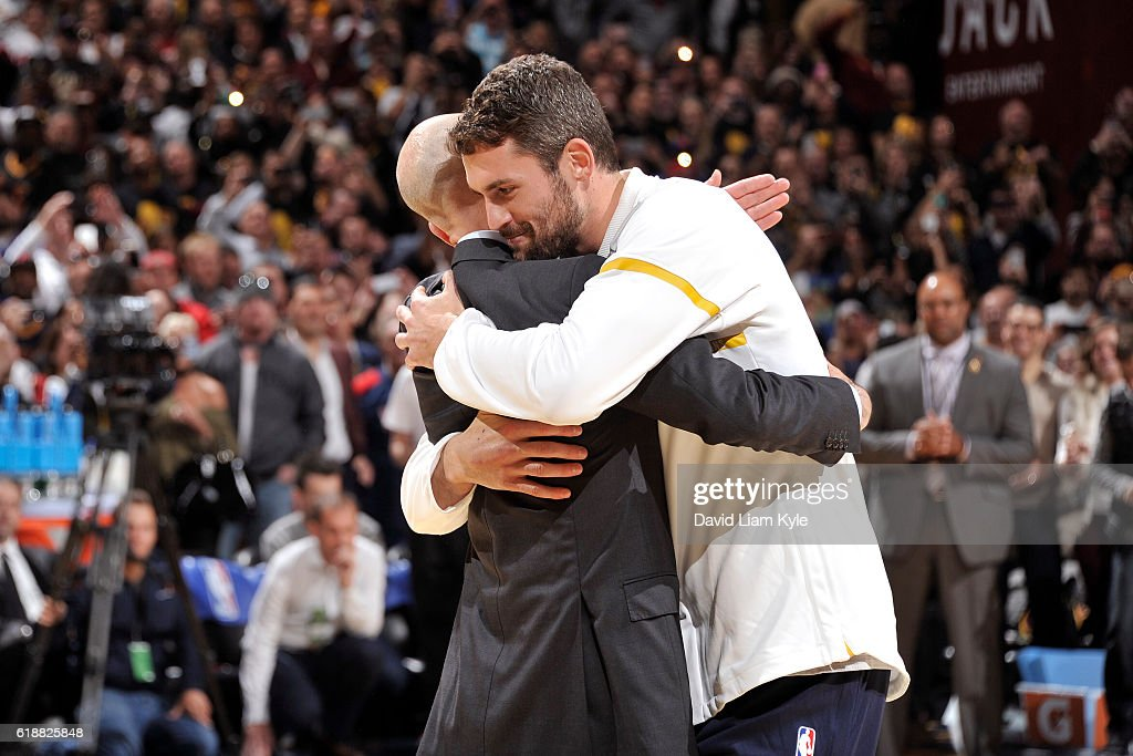 Commissioner, Adam Silver hugs Kevin Love #0 of the Cleveland Cavaliers after presenting him with his championship ring before the game against the New York Knicks on October 25, 2016 at Quicken Loans Arena in Cleveland, Ohio.