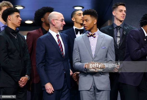 NBA commissioner Adam Silver speaks to Markelle Fultz before the first round of the 2017 NBA Draft at Barclays Center on June 22 2017 in New York...