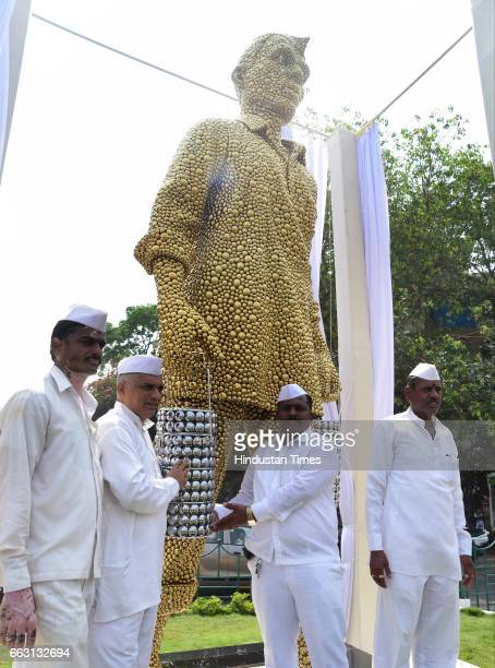Commissioner Ajoy Mehta and Industrialist and Art Aficionado Harsh Goenka inaugurate the art installation of 'The Dabbawala' to honour the work of...
