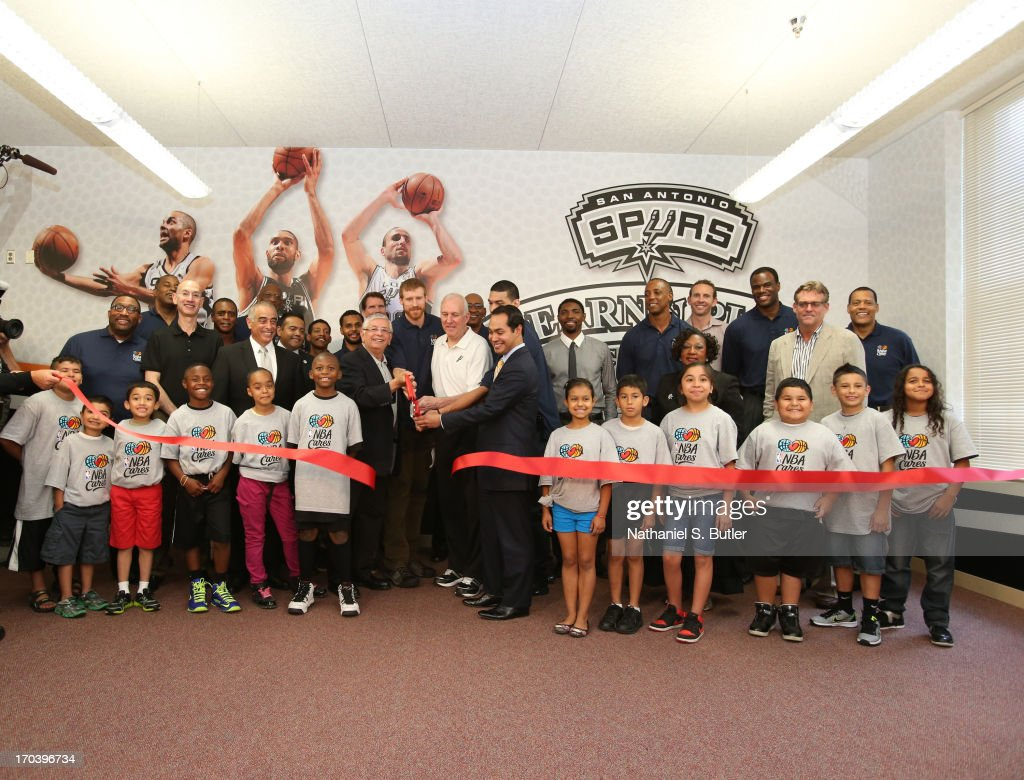 NBA Commissioner David Stern and Head Coach Gregg Popovich of the San Antonio Spurs cuts the ribbon to open the 2013 NBA Cares Legacy Project as part of the 2013 NBA Finals on June 7, 2013 at the Wheatley Middle School in San Antonio, Texas.
