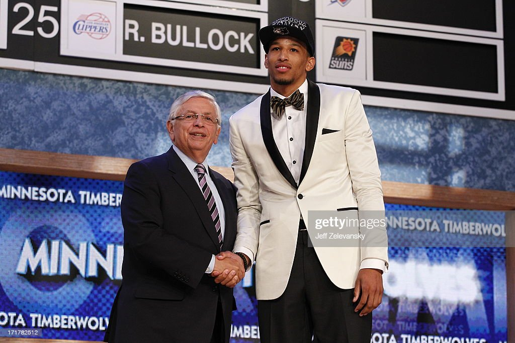 NBA Commissioner David Stern congratulates Andre Roberson, who was selected number 26 overall by the Minnesota Timberwolves during the 2013 NBA Draft at the Barclays Center on June 27, 2013 in Brooklyn, New York.