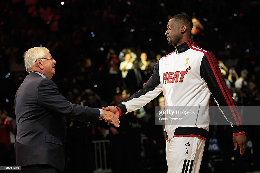 NBA Commissioner David Stern greets (R) Dwyane Wade #3 of the Miami Heat at the 2012 NBA Championship ring ceremony prior to the game against the Boston Celtics at American Airlines Arena on October 30, 2012 in Miami, Florida.