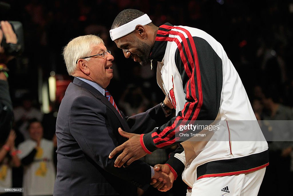 NBA Commissioner David Stern greets (R) LeBron James #6 of the Miami Heat as the Miami Heat are given their 2012 NBA Championship rings at a ceremony prior to the game against the Boston Celtics at American Airlines Arena on October 30, 2012 in Miami, Florida.