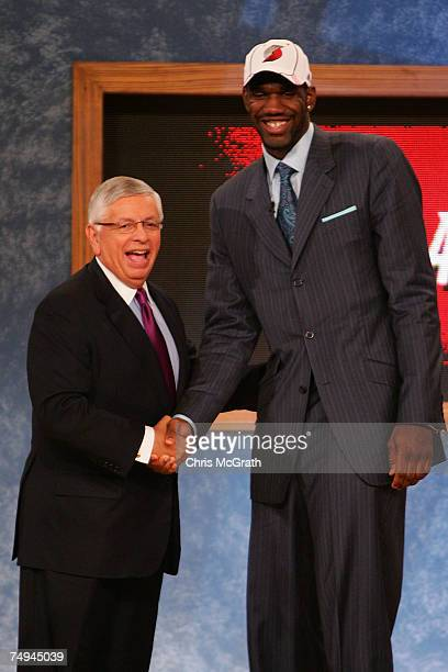 Commissioner David Stern poses for a photo with Greg Oden of Ohio State after he was drafted first by the Portland Trailblazers during the 2007 NBA...