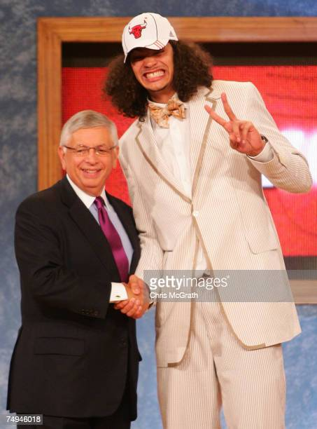 Commissioner David Stern poses for a photo with Joakim Noah of Florida after he was drafted ninth by the Chicago Bulls during the 2007 NBA Draft at...