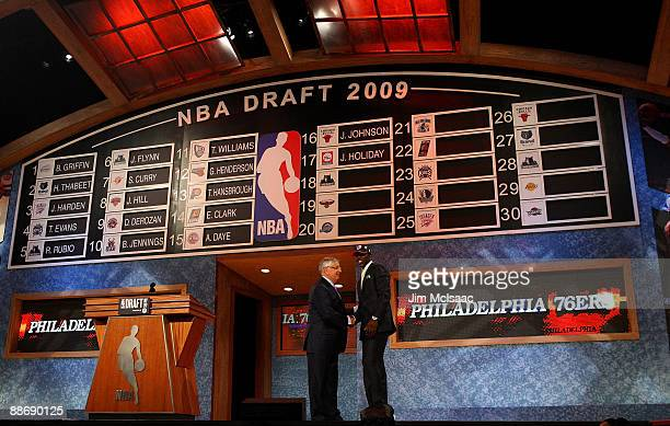Commissioner David Stern poses for a photograph with the seventeenth overall draft pick by the Philadelphia 76ers Jrue Holiday during the 2009 NBA...
