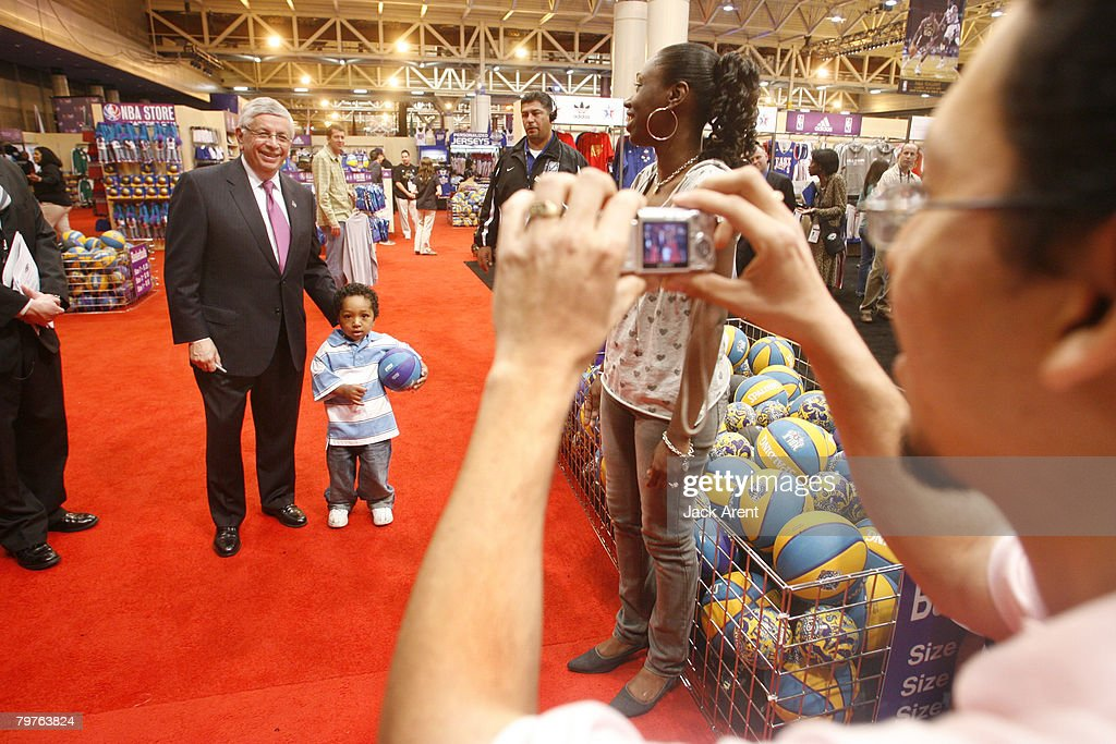 Commissioner David Stern poses for a picture with a young fan at the NBA Jam Session during the 2008 All Star Weekend February 14 2008 in New Orleans...