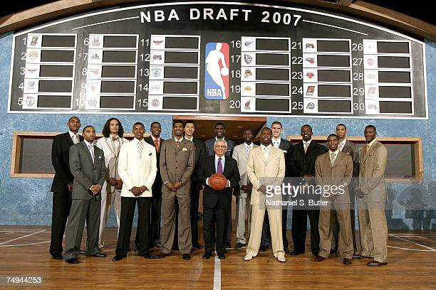 Commissioner David Stern poses with Al Horford Acie Law IV Joakim Noah Nick Young Kevin Durant Corey Brewer Yi Jianlian Greg den Julian Wright Rodney...