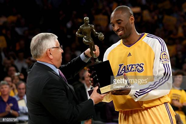 Commissioner David Stern presents Kobe Bryant of the Los Angeles Lakers the MVP Trophy before the start of Game Two of the Western Conference...