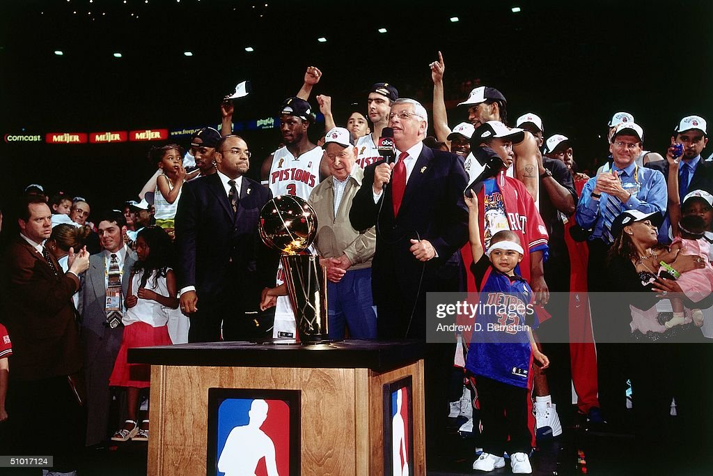 Commissioner David Stern presents the championship trophy to Detroit Pistons owner William Davidson after their win over the Los Angeles Lakers in game five of the 2004 NBA Finals at The Palace of Auburn Hills on June 15, 2004 in Auburn Hills, Michigan.