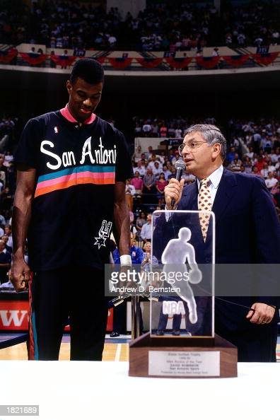 Commissioner David Stern presents the Rookie of the Year award to David Robinson of the San Antonio Spurs at the Alamodome during the 1990 season in...
