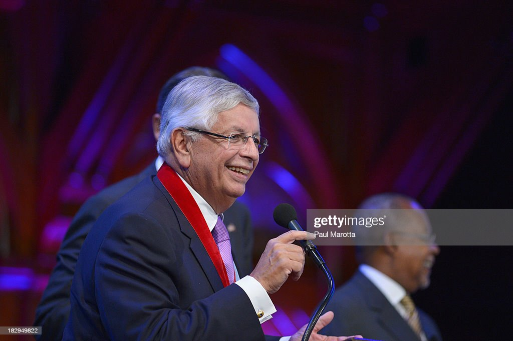 Commissioner <a gi-track='captionPersonalityLinkClicked' href=/galleries/search?phrase=David+Stern&family=editorial&specificpeople=206848 ng-click='$event.stopPropagation()'>David Stern</a> receives the 2013 W.E.B. Du Bois Medal at a ceremony at Harvard University's Sanders Theatre on October 2, 2013 in Cambridge, Massachusetts.