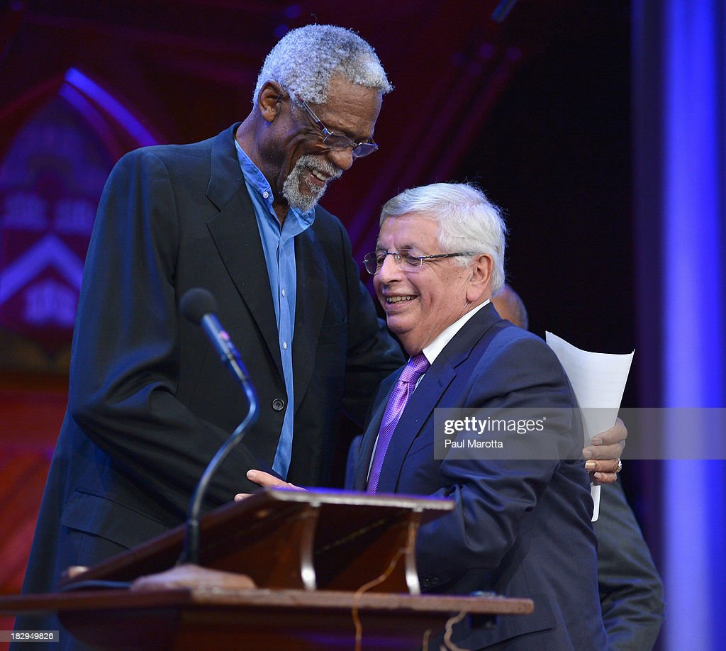 Commissioner David Stern (R) receives the 2013 W.E.B. Du Bois Medal from Former Boston Cenltic Bill Russell at a ceremony at Harvard University's Sanders Theatre on October 2, 2013 in Cambridge, Massachusetts.