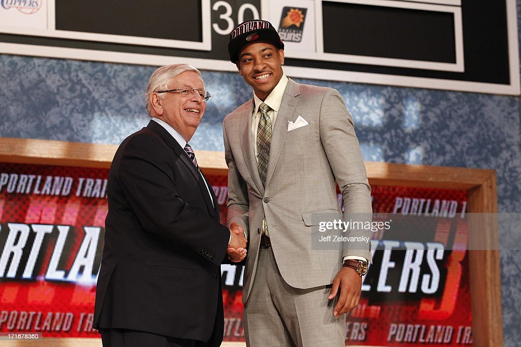NBA Commissioner David Stern shakes hands with C.J. McCollum who is drafted number 10 overall by the Portland Trailblazers during the 2013 NBA Draft at the Barclays Center on June 27, 2013 in the Brooklyn borough of New York City.