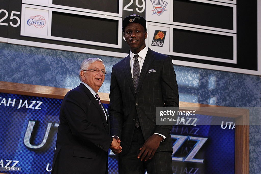 NBA Commissioner David Stern shakes hands with Gorgui Dieng who is drafted number 21 overall by the Utah Jazz during the 2013 NBA Draft at the Barclays Center on June 27, 2013 in the Brooklyn borough of New York City.