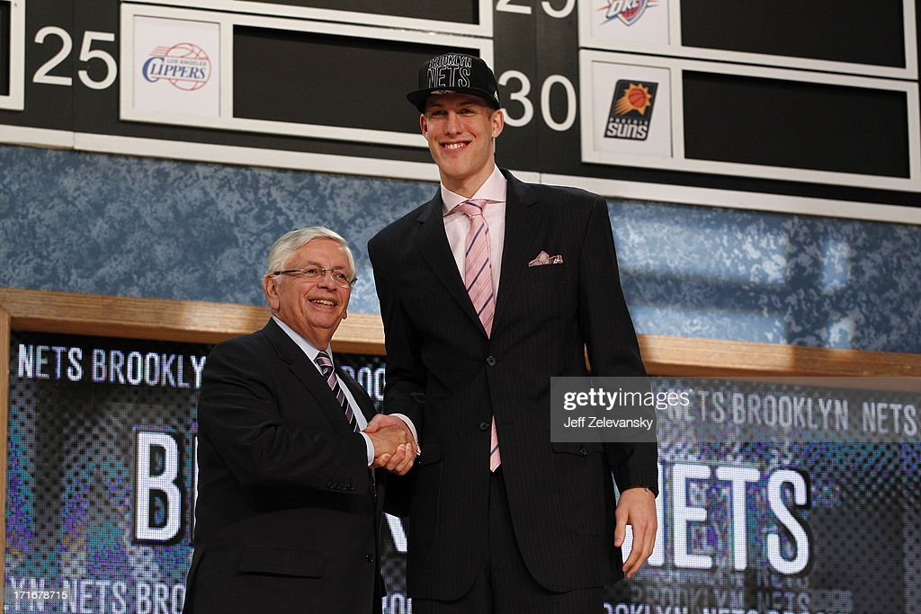 NBA Commissioner David Stern shakes hands with Mason Plumlee who is drafted number 22 overall by the Brooklyn Nets during the 2013 NBA Draft at the Barclays Center on June 27, 2013 in the Brooklyn borough of New York City.
