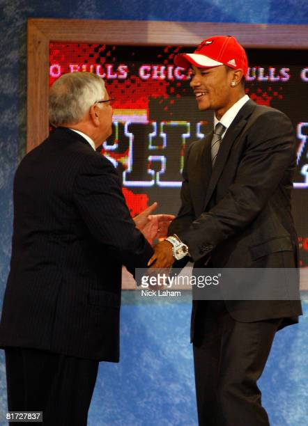 Commissioner David Stern shakes hands with number one draft pick for the Chicago Bulls Derrick Rose during the 2008 NBA Draft at the Wamu Theatre at...