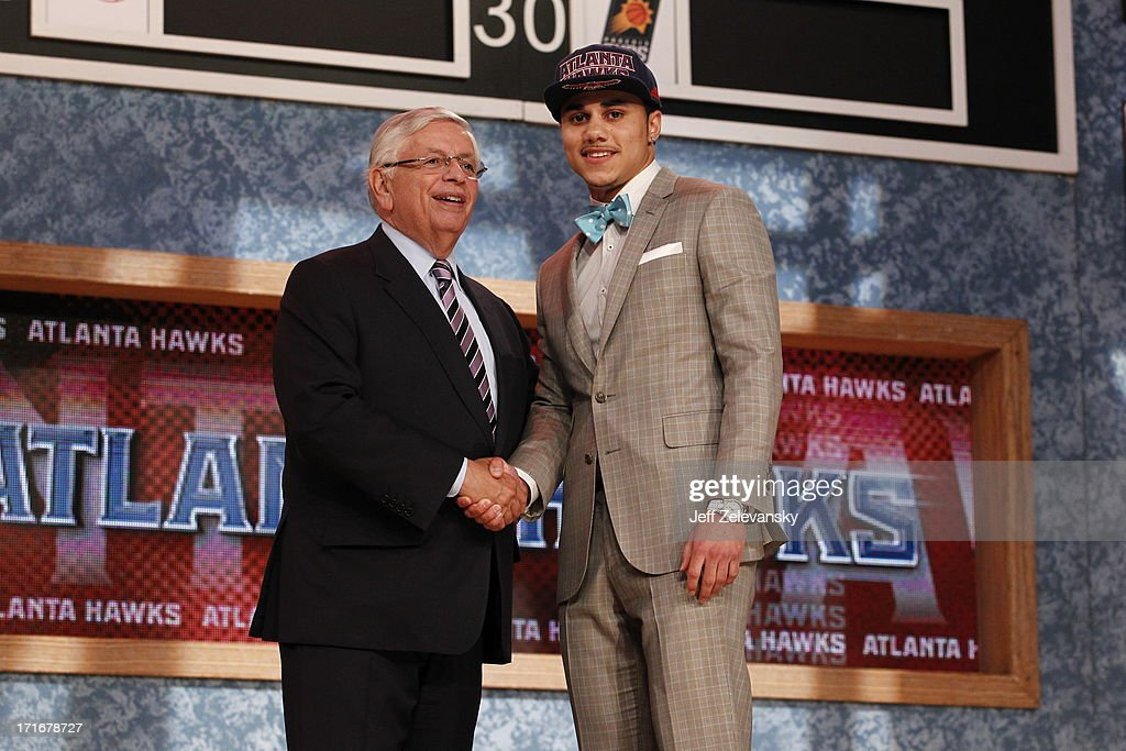 NBA Commissioner David Stern shakes hands with Shane Larkin who is drafted number 18 overall by the Atlanta Hawks during the 2013 NBA Draft at the Barclays Center on June 27, 2013 in the Brooklyn borough of New York City.