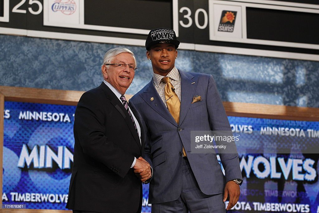 NBA Commissioner David Stern shakes hands with Trey Burke, who is drafted number 9 overall by the Minnesota Timberwolves during the 2013 NBA Draft at the Barclays Center on June 27, 2013 in the Brooklyn borough of New York City.