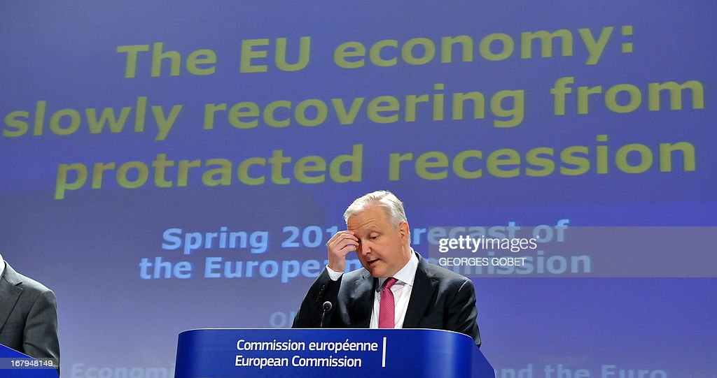 EU commissioner Economic and Monetary Affairs Olli Rehn attends a press conference on the spring European Economic Forecast on May 3, 2013 at the EU Headquarters in Brussels. The EU's Economic Affairs commissioner Olli Rehn on Friday said it would be 'reasonable' to give France two extra years to meet the EU deficit target of 3 percent. Rehn offered France extra time after the European Commission's spring forecasts painted a pessimistic picture of the French economy over the next two years, with its deficit notably rising sharply from 3.9 percent of GDP this year to 4.2 percent next year. AFP PHOTO / GEORGES GOBET