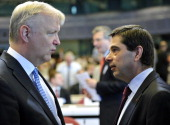 EU commissioner Economic and Monetary Affairs Olli Rehn speaks with Portuguese finance minister Vitor Gaspar at the opening of a conference on the...