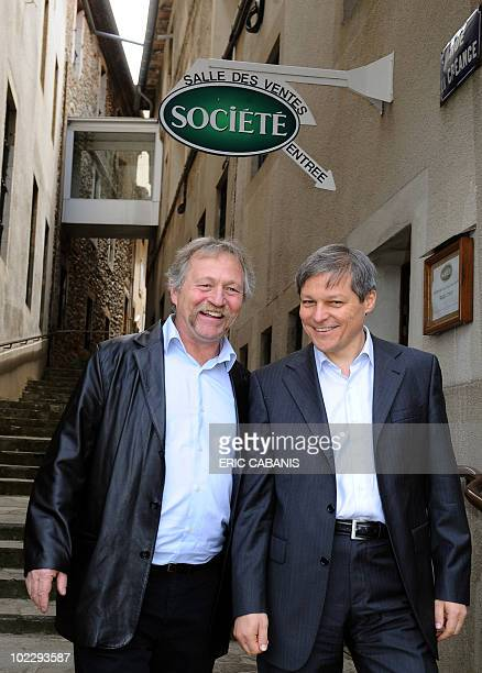 Commissioner for Agriculture and Rural Development Romania's Dacian Ciolos is pictured with Green Ecology party member Jose Bove after visiting a...
