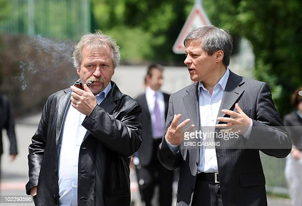 Commissioner for Agriculture and Rural Development Romania's Dacian Ciolos talks to Green Ecology party member Jose Bove after visiting a Roquefort...